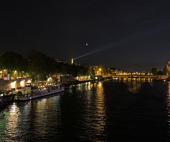 View of the Seine and the Eiffel Tower at night.